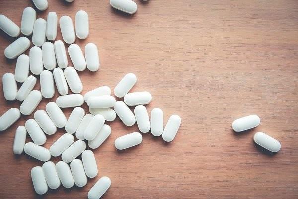 medicine pill on wood table