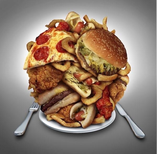 Ăn một lượng thức ăn lớn bất thường là một trong những triệu chứng của rối loạn ăn uống vô độ