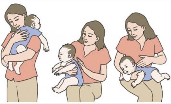 Một số tư thế giúp trẻ ợ hơi sau khi ăn